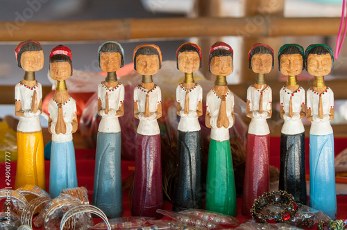 Fotografie, Obraz  Wood carved figurines from long necked hilltribe, Mae Hong Song, Thailand