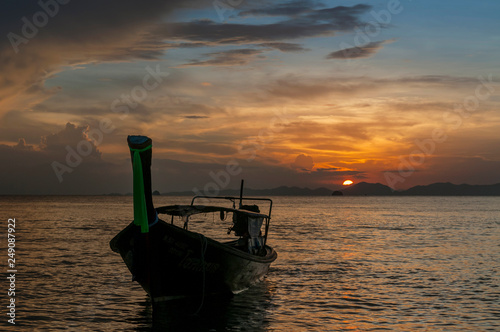 Fényképezés  Long tail fishing boat at sunset, Koh Phi Phi, Thailand.
