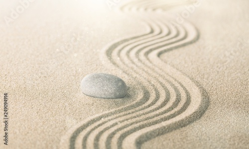 Foto op Plexiglas Stenen in het Zand zen garden with raked sand and a smooth stone