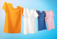 Colorful T-shirts Hanging On A...