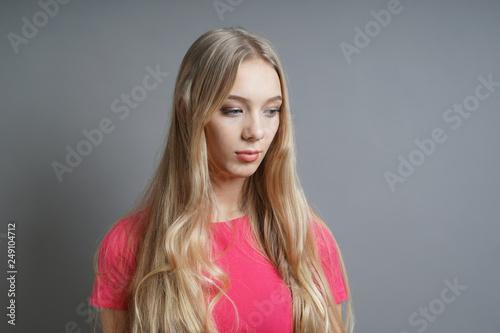 melancholic introverted sad girl looking down - teenage depression concept - gra Canvas Print