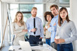 Small group of business people standing and posing at office. Start up business concept. Multi ethnic goroup.