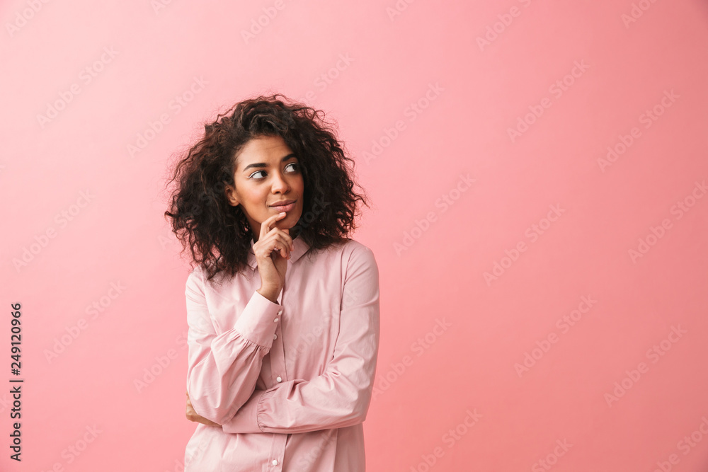 Fototapety, obrazy: Happy beautiful young african woman posing isolated over pink wall background.