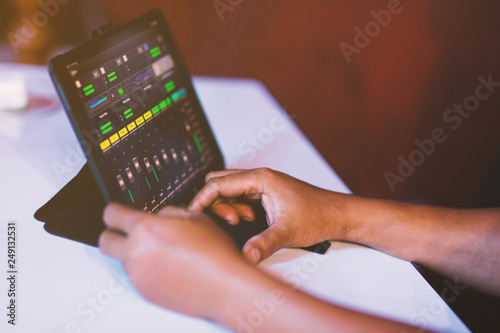 Fotografie, Obraz  Sound engineer working at mixing panel in sound studio