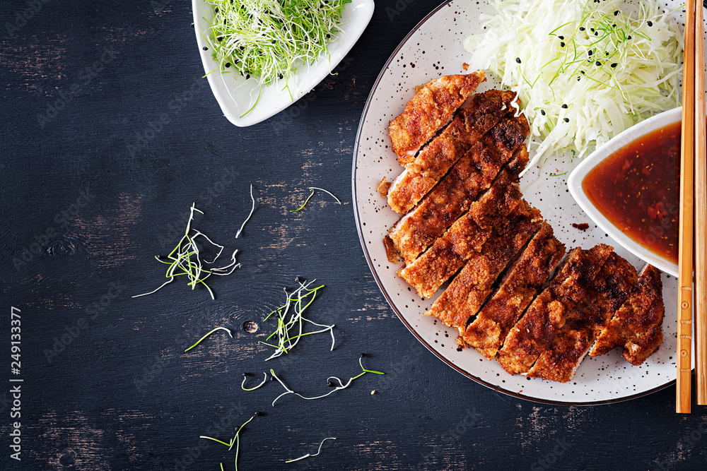 Fototapety, obrazy: Japanese cuisine. Deep-fried pork chop, or Japanese chop with cabbage and tonkatsu sauce. Top view