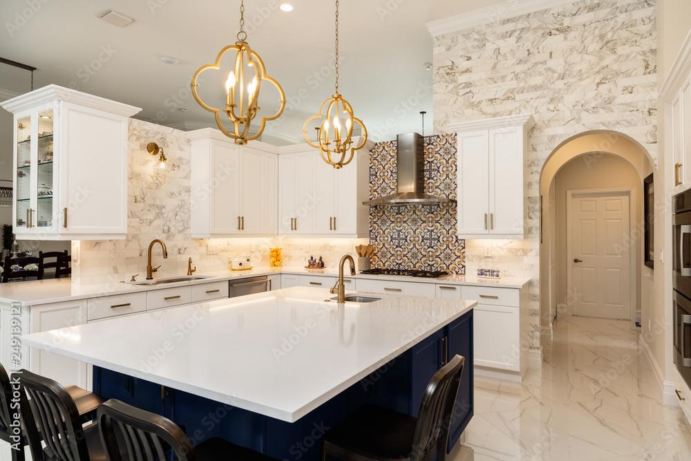 Fototapeta Modern White Kitchen in Estate Home