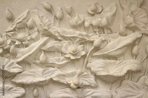 Beautiful white lotus stucco patterned on the boundary wall Canvas Print