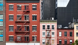Old tenement houses with fire escapes in New York City, USA. - 249145386