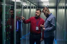 Adult Bearded Engineers In Server Room