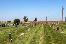 Lonely Country Cemetery That Has Just Been Mowed On The Plains With Plowed Field Behind