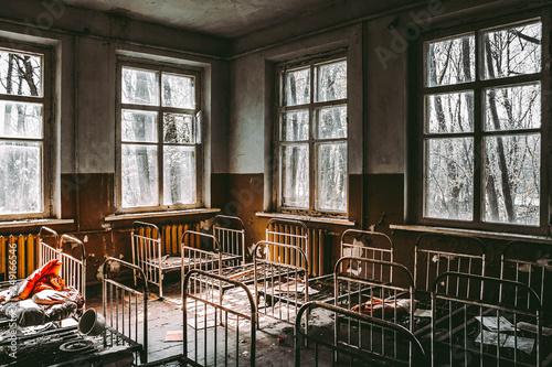 Fotografie, Obraz  Bedroom in abandoned kindergarten in destroyed village Kopachi (10 km exclusion