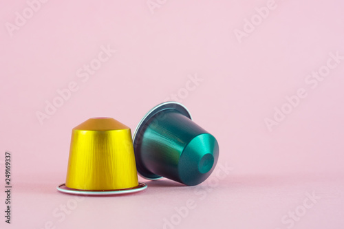 Canvastavla  yellow and green capsule coffee on a  pink background