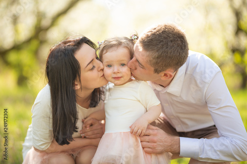 Photo  Love, happy family on vacation in a blooming garden in spring, summer