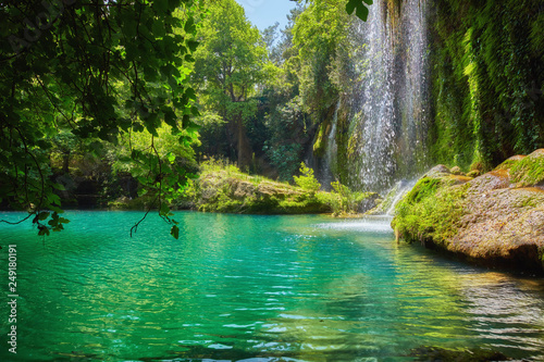 Foto auf Leinwand Wasserfalle Pond with clear blue water in tropical