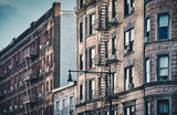New York old buildings with fire escapes, color toned picture, USA. - 249190556