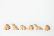 Crackers, Baby Cookies, Dinosaurs On A White Background. Baby Food. Food Snack For School Children And Toddlers.
