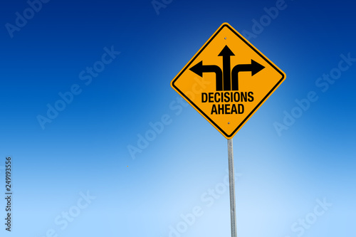 Fototapeta Descisions ahead road sign in warning yellow with blue background, - Illustratio