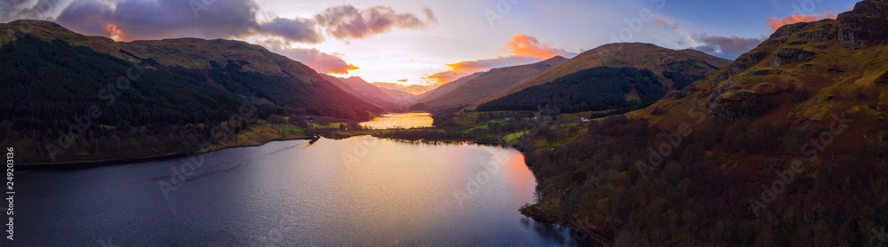 Fototapeta Scottish beautiful colorful sunset landscape with Loch Voil, mountains and forest at Loch Lomond & The Trossachs National Park