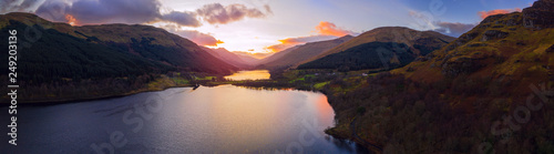 Foto auf AluDibond Schokobraun Scottish beautiful colorful sunset landscape with Loch Voil, mountains and forest at Loch Lomond & The Trossachs National Park