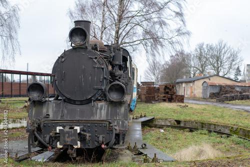 Old rusty locomotive of the narrow gauge railway  Place of