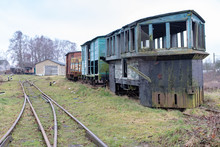 Old Rusty Wagon Of The Narrow Gauge Railway. Place Of Stationing Of Old Steam Locomotives.