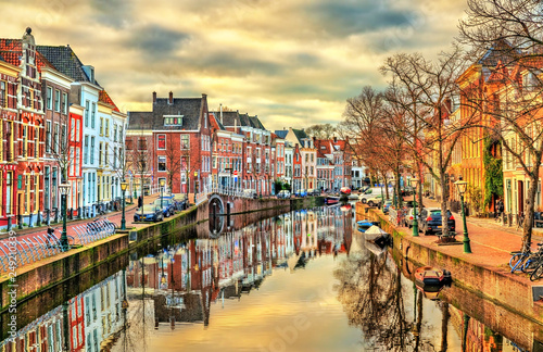 Traditional houses beside a canal in Leiden, the Netherlands - 249210339