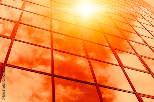 Obraz na plátne  hot weather summer season sunny reflect on glass windows building