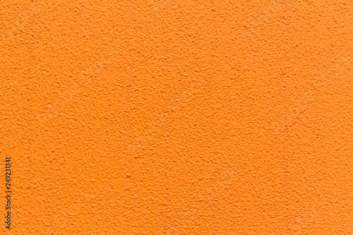 Fotografering  orange stucco wall texture pattern for background.
