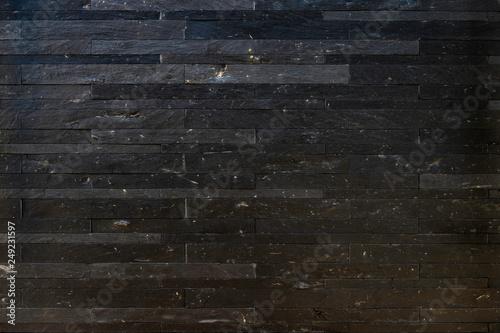 Fototapeta  黒い石の壁面
