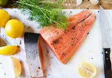 Fresh Sliced Salmon On A Cutti...