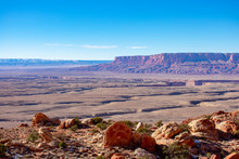 Scenic Bird Eye Overlook Of Colorado River Plateau With Meanders With Blue Sky On A Sunny Day. Rock Outcrop Covered With Light Snow