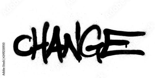 graffiti change word sprayed in black over white