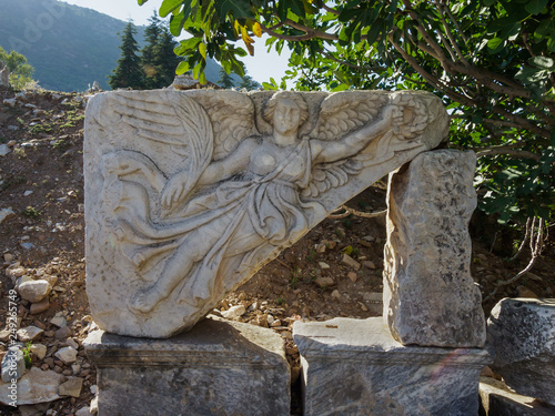 Fotografija  Stone carving of the goddess Nike at the ruins of the ancient city of Ephesus, S