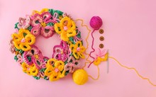 Free Form Crochet Flower Wreath And  Balls Of Wool