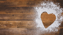 Abstract Heart Shape Made Of Flour Powder On Wooden Table, Love Concept