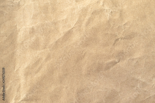 Fotomural  Brown crumpled paper texture background.