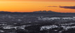 Panorama view from the top of Idre fjäll in Sweden during a sunset. Fulufjället in the distant with forests spreading out below.
