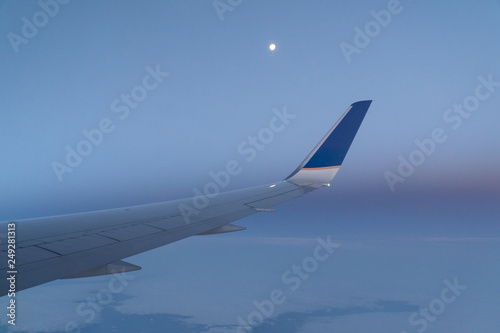 Fotografia  Full Moon during a flight over the Atlantic Ocean