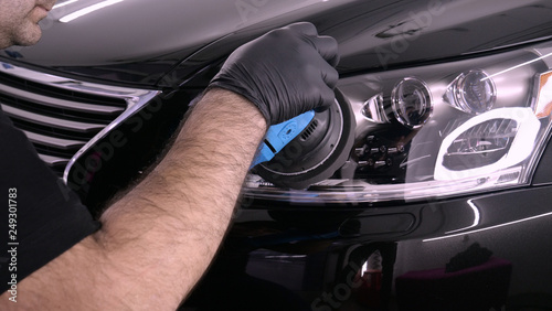 Obraz A professional bodywork and headlamp polishing worker will transport the car after painting or preparing for sale. Concept of: Freshen cars, Automotive center, Service, Professional. - fototapety do salonu