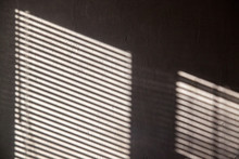 Interesting Abstract Background With A Shadow From The Blinds On The Wall.