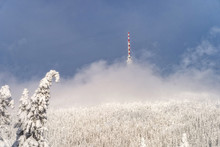 Telecommunication Tower On The Barren Hill Covered With Low Clouds, Praded, Czech Republic.