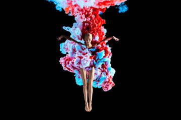 Modern art collage. Concept ballerina with colorful smoke. Abstract formed by color dissolving in water on black background