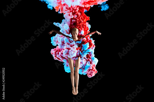 Obraz Modern art collage. Concept ballerina with colorful smoke. Abstract formed by color dissolving in water on black background - fototapety do salonu