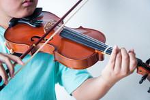Boy Playing Violin In Room