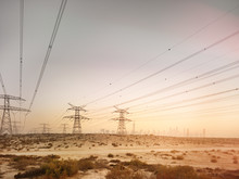 Electric Towers In Desert With...