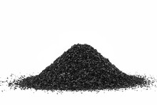 Activated Carbon In The Water Filter Isolated On White Background. Activated Carbon.