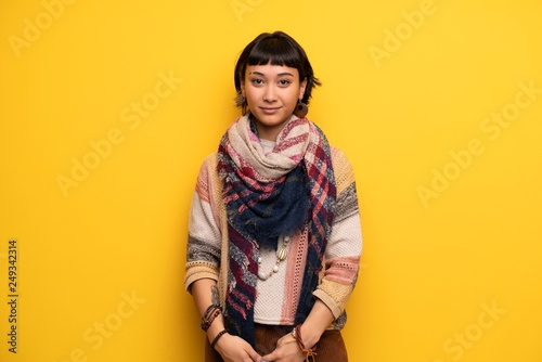 Young hippie woman over yellow wall portrait Fototapet