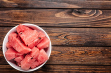 Slices Of Fresh Watermelon On Plate Over Wood Background,