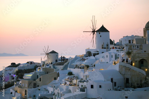 Poster Light pink Fabulous picturesque village of Oia in Santorini island at sunset, Greece
