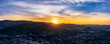 Panoramic Sunrise above Mountain and City